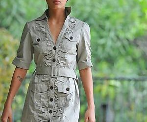 Explorer Amia Miley sheds her jungle clothes to cartwheel..