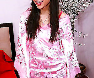 Cute asian beaver in pink gets her fanny banged with..