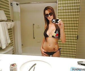 Sunglass wearing ex-gf Mandy Haze snapping selfies of her..