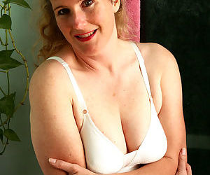 Mature lady Magnolia takes off her bra and panties sitting..