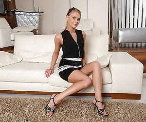 Blonde Euro babe Kattie Gross unzips from her maid's uniform