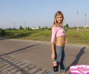 Leggy teen girl in blue jeans ducks behind a blind to..
