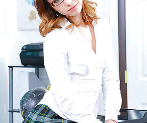 Glasses topped Euro babe Aurora Belle struts in knee high..