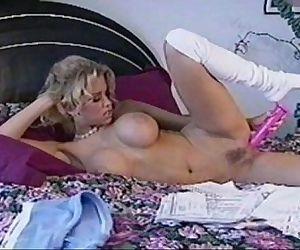 Jenna Jameson masturbating with a pink dildo