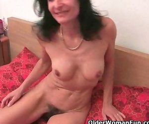 Grandma Emanuelle masturbates and gets fingered by the..