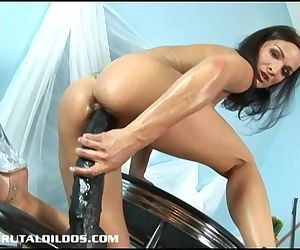 Petite European brunette filling her tight pussy with a..