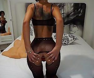 Busty sex-bomb Anisyia in fishnet bodysuit plays with..