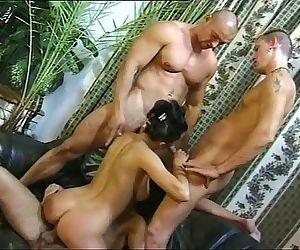 Stunning hot brunette gang banged by three cocks