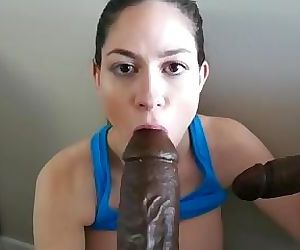 Brunette Sucks Two Massive BBC Dildos