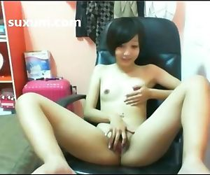 Cute Asian teen getting naked and..