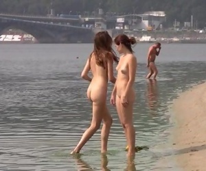 Wild youthful nudists play with each other in sand - 5 min
