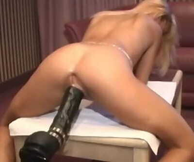 Petite french ash-blonde demolished by a fierce dildo machine